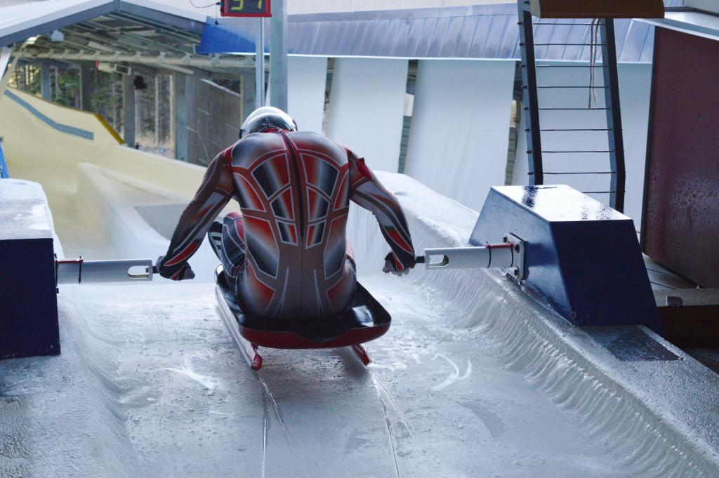 Luge athlete pushing off from start, Whistler Sliding Centre