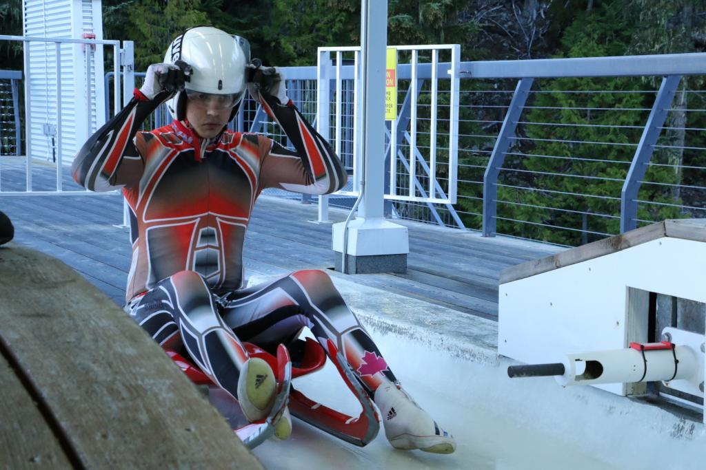 Young luge athlete at start, Whistler Sliding Centre