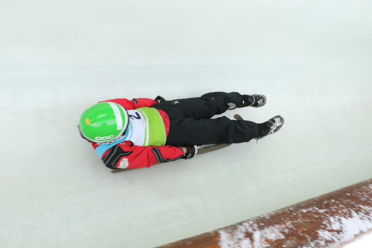 Young luge athlete in track, Whistler Sliding Centre
