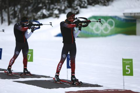 Biathletes shooting in standing position at Whistler Olympic Park