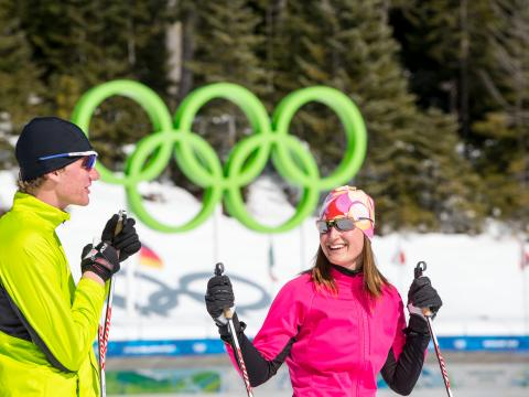 Cross country skiers in front of Olympic Rings